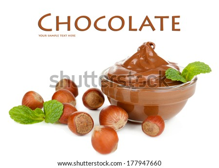 Sweet chocolate hazelnut spread with whole nuts and mint isolated on white - stock photo
