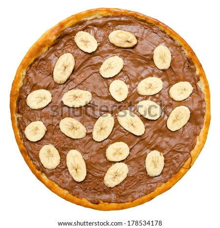 sweet chocolate pizza with banana slices, isolated, top view - stock photo