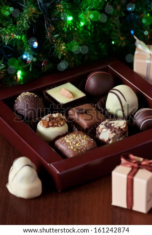 Sweet chocolate truffles in a box. - stock photo