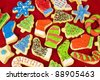 sweet christmas cookies decorating with icing and sprinkles - stock photo