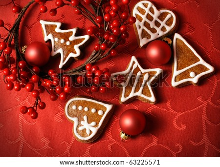 sweet christmas gingerbreads and red christmas ornaments - stock photo