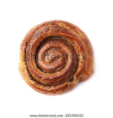 Sweet cinnamon bun roll swirl isolated over the white background - stock photo