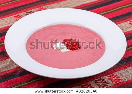 Sweet cold strawberry soup with fruit and ice cream, close up - stock photo