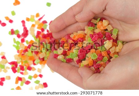Sweet colorful candied fruits in the hands of - stock photo