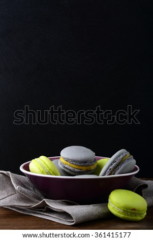 Sweet colorful Pistachios macaroon in a plate. French dessert
