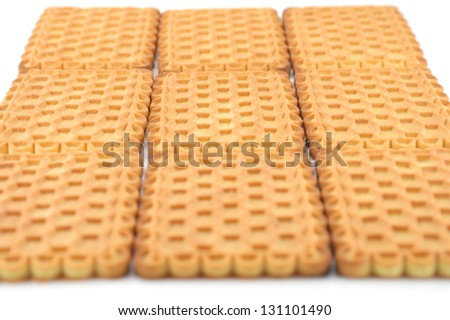 Sweet cookie over white. Shallow DOF - stock photo