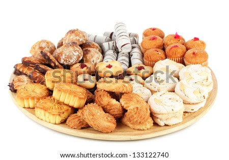 Sweet cookies on wooden plate isolated on white - stock photo