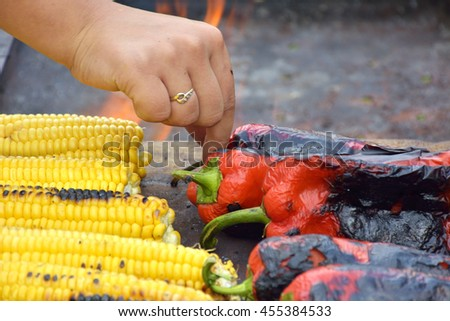 sweet corn and paprika on grill