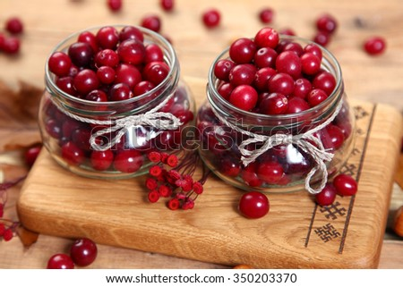 sweet cranberry on wooden table - stock photo