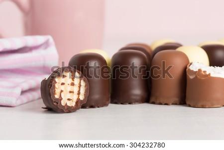 Sweet cream coated with chocolate - stock photo