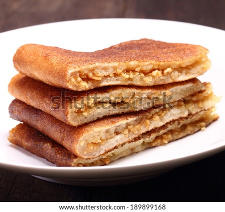 Sweet crispy pancake filled with peanuts, sugar and sweet corn.