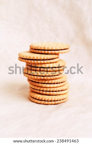 Sweet crispy yellow biscuits on textile background