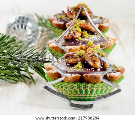 Sweet Cupcake with Christmas decoration  on a wooden table. Selective focus - stock photo