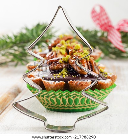 Sweet Cupcake with Christmas tree  on a wooden table. Selective focus - stock photo