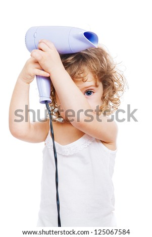 Sweet curly girl with a hair dryer - stock photo