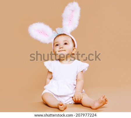 Sweet cute baby in costume easter bunny - stock photo