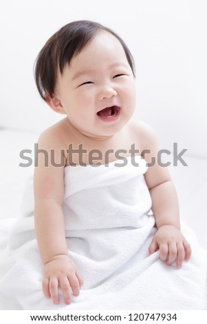 Sweet cute girl Baby smile and sitting on bed at home, asian child - stock photo