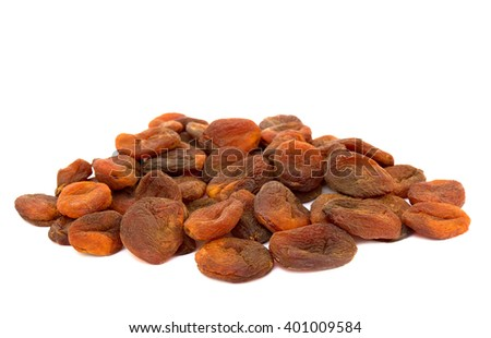Sweet dark dried apricots on white background - stock photo