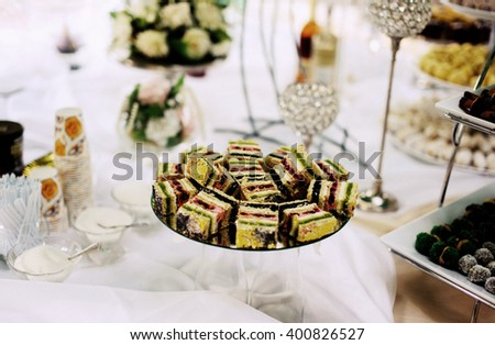 sweet desk with cakes and fruits