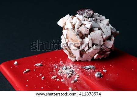 Sweet dessert. Delicious meringue on the red plate, black background - stock photo