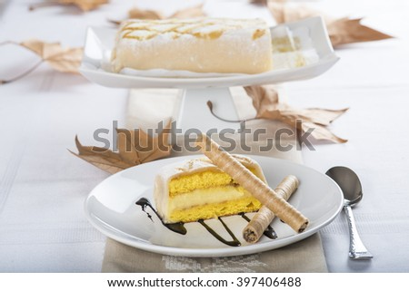 Sweet dessert made of sponge cake marzipan and pastry cream covered with glass burnt sugar - stock photo