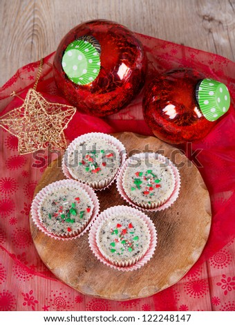 Sweet dessert - mini cheesecakes in muffin forms with red Christmas tree balls