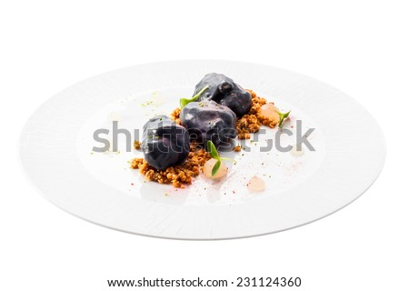 Sweet dessert. Souffle in chocolate on the plate. Object on a white background. - stock photo