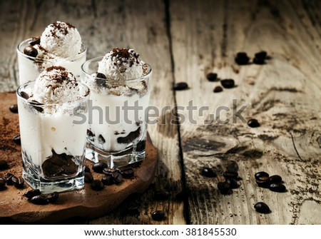 Sweet dessert with vanilla ice cream, chocolate cookies, coffee, coconut, selective focus - stock photo