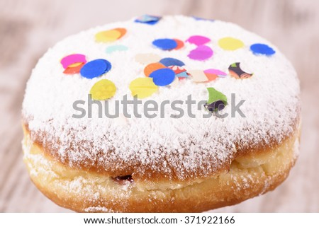 sweet donut at carnival with confetti