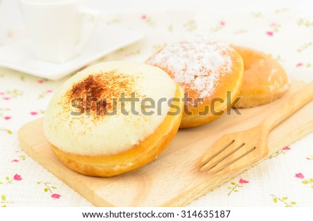 Sweet Donut on wooden plate,delicious baked