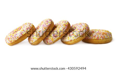 Sweet donuts with color glaze isolated on white background. Sweet dish for tea. The dessert of donuts for Breakfast. Tasty food cakes. Delicious classic cakes: fried doughnuts glazed with caramel. - stock photo