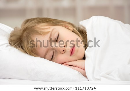 Sweet Dream. A little girl of four years. - stock photo