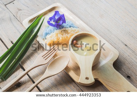 Sweet durian with soft sticky rice on the wooden background
