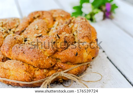 Sweet Easter bread with flowers decoration - stock photo
