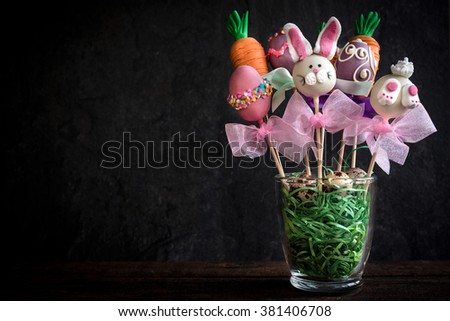 Sweet Easter cake pops on wooden background with copy space  - stock photo