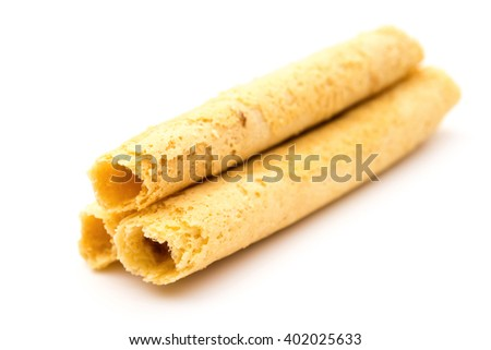 sweet egg rolls on a white background