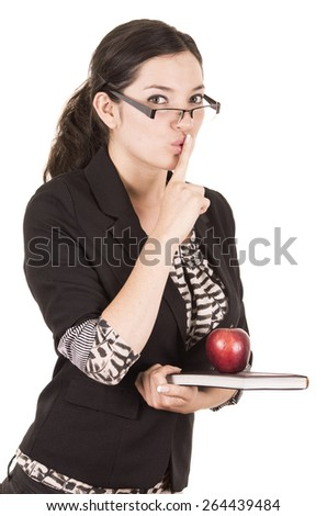 sweet female teacher holding red apple gesturing silence isolated on white - stock photo