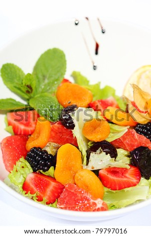 Sweet, fresh and tasty fruit salad - stock photo