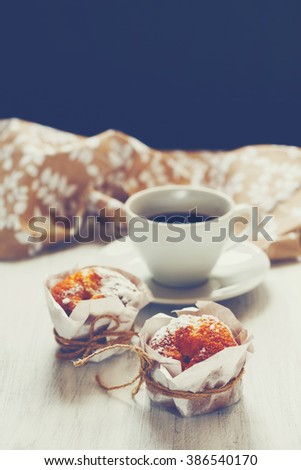 Sweet Fresh Baked Homemade Muffins with Cup of Black Coffee for Morning Breakfast. Copy Space. Selective Focus. Image Toned. - stock photo