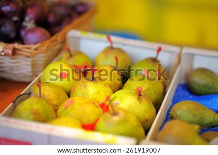 Sweet fresh bio pears on Paris farmer agricultural market