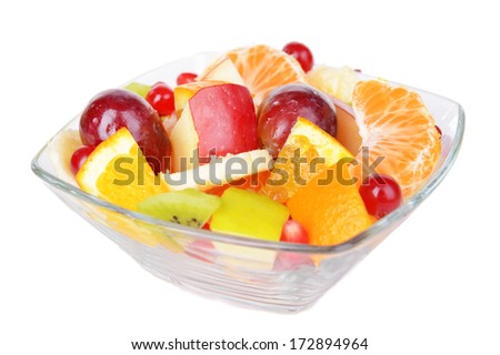 Sweet fresh fruits in bowl isolated on white