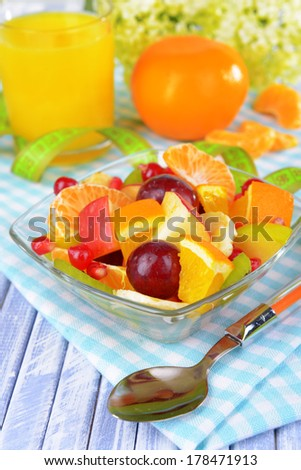 Sweet fresh fruits in bowl on table close-up