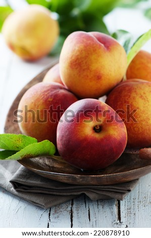 Sweet fresh peaches on the wooden table, selective focus