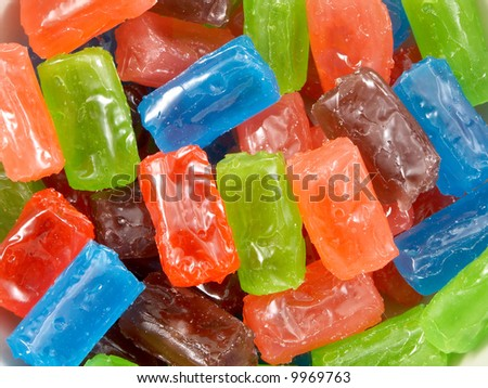 Sweet fruit color candy on white background - stock photo