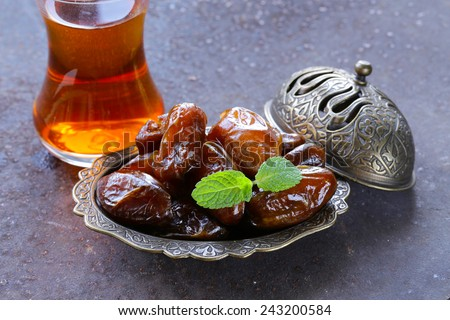 sweet fruit dates for traditional tea party - stock photo