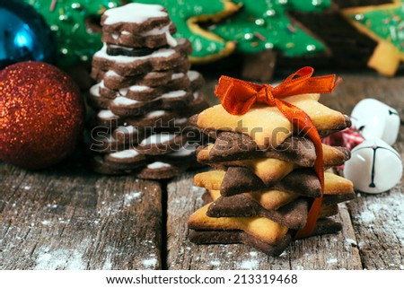 Sweet gingerbread cookies on the wooden background.Selective focus on the front cookies - stock photo