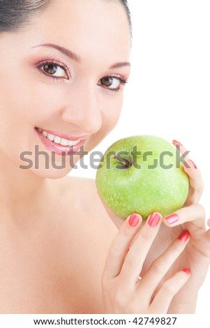 sweet girl eating green apple on white background