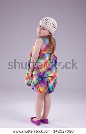 sweet girl looking back, isolated on studio shot - stock photo