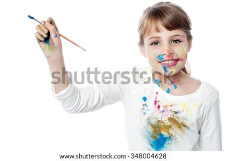 Sweet girl painting creatively - stock photo
