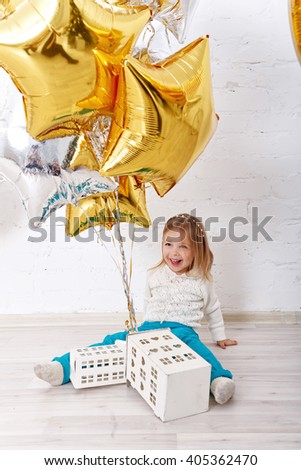Sweet girl playing with balloons. The atmosphere of joy, fun, holiday. Birthday. - stock photo